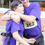Trevor and Katie Lewis embrace after completing last year's Thunder Bay Marathon. (Photo courtesy of Thunder Bay Chronicle-Journal/Brent Linton. Used by permission.)