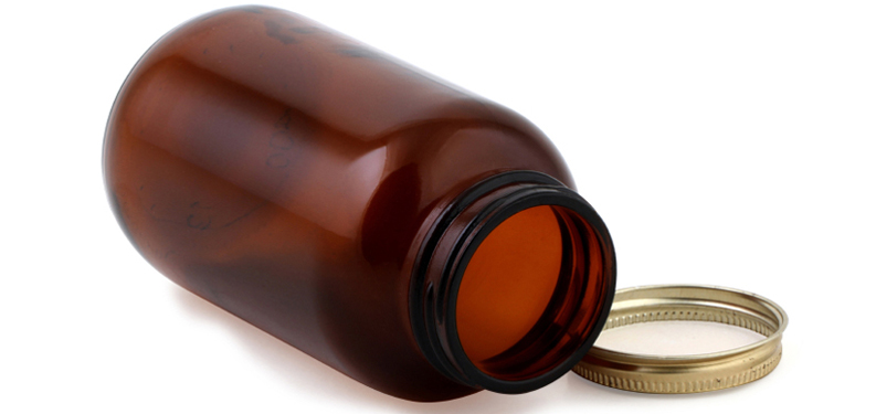 empty medicine bottle and cap